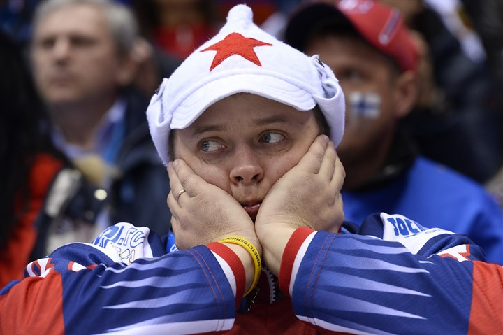 russia0220 A Russia supporter reacts during Team Russia's 3-1 loss to Finland Wednesday in the Olympic men's hockey quarterfinals.