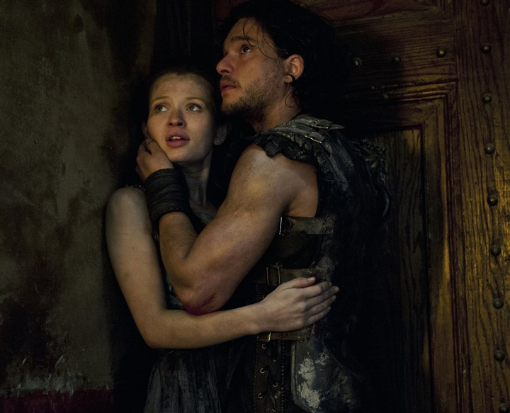 "Pompeii2-2 Milo (Kit Harington) and Cassia (Emily Browning) in the movie ""Pompeii."""