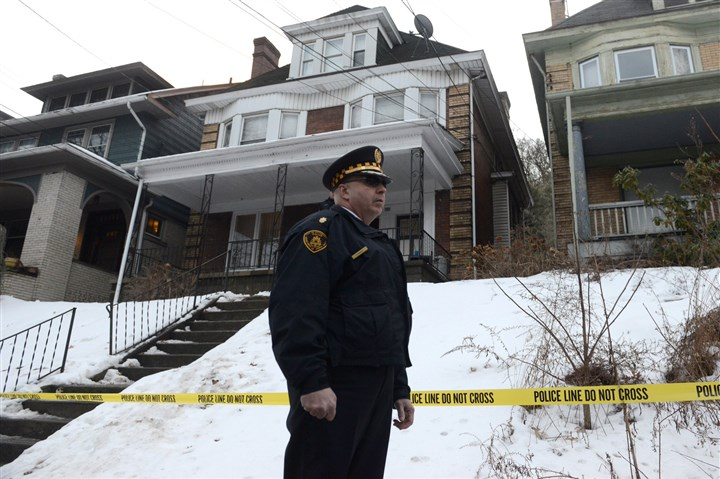 Wolfe sisters death investigation  On Feb. 19, police enter 703 Chislett St. in East Liberty while investigating the killing of two sisters that occurred next door.