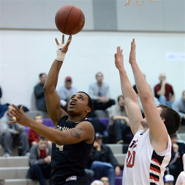 randall0220 Gateway's Delvon Randall drives to the hoop against Upper St. Clair's Will Ross Wednesday night in a Class AAAA WPIAL first-round playoff game.