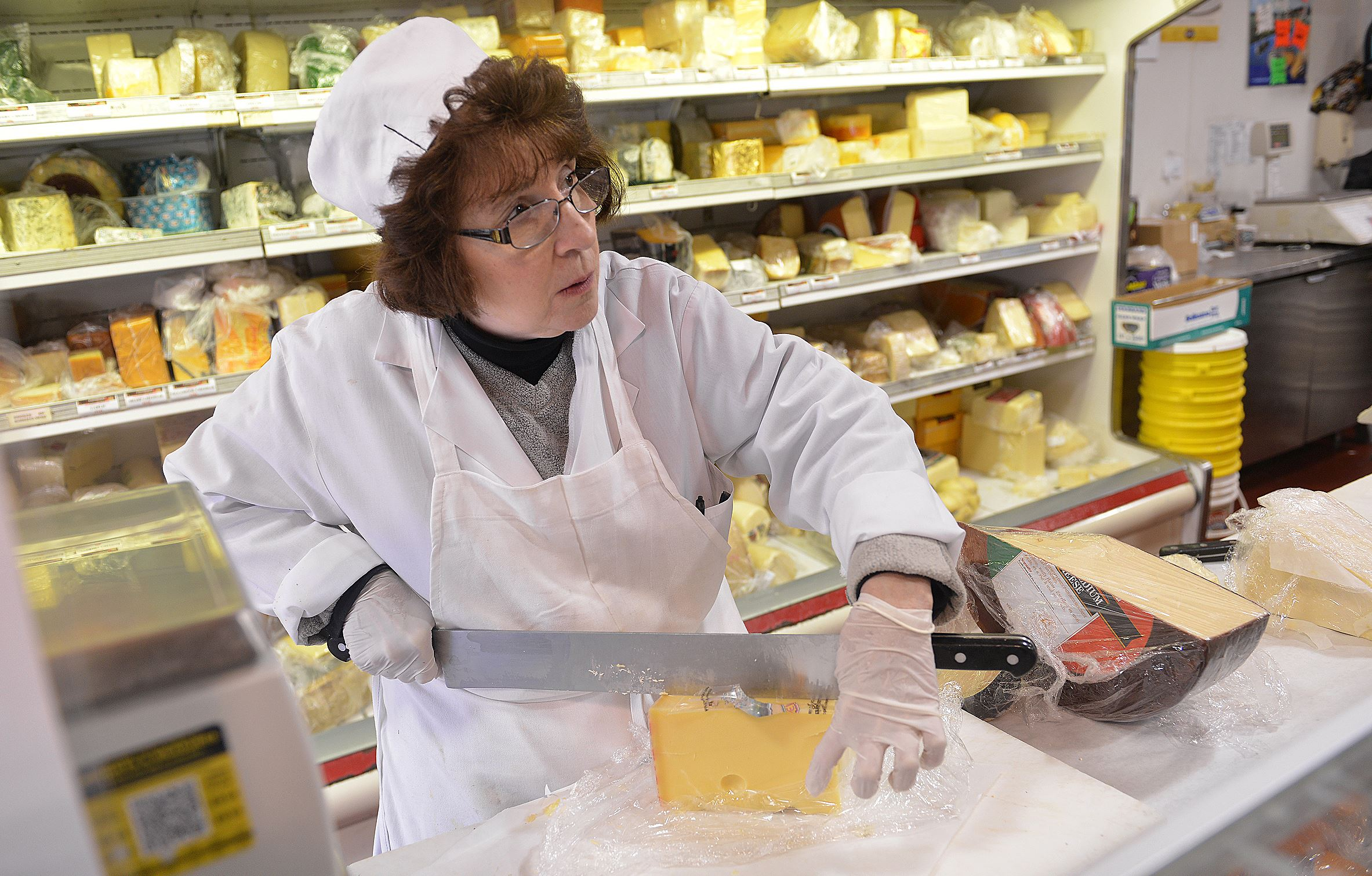 Carol Pascuzzi 3 Carol Pascuzzi, cheesemonger at Penn Mac since 1984, prepares to cut a pound of Emmenthaler.