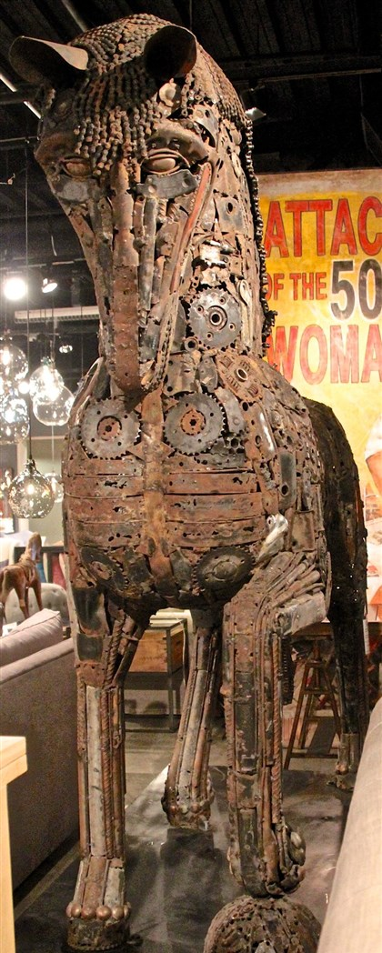 styleHorse8-7 Leonardo is a massive horse sculpture made of recycled motorcycle and car parts by Cisco Brothers.