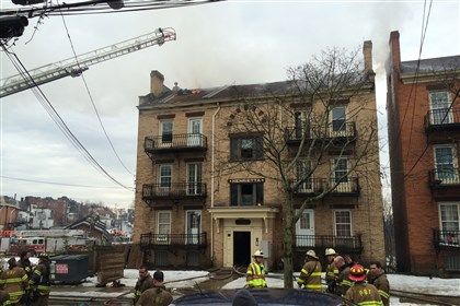 Brighton Heights fire Firefighters respond to a four-alarm blaze in Brighton Heights.