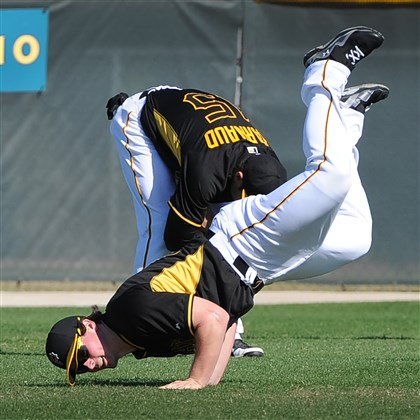 Pirates outfielder Travis Snider Pirates outfielder Travis Snider stretches it out before morning workouts at Pirate City Bradenton, Fla.