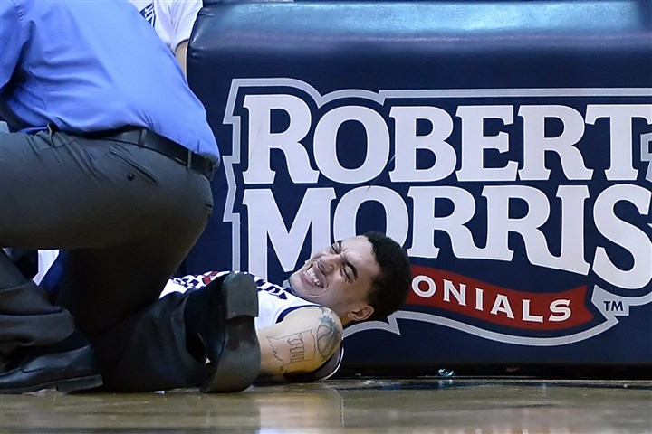20140220mfrmusports02-1 Robert Morris' Stephan Hawkins has his ankle attended to after getting injured in the first half against LIU.