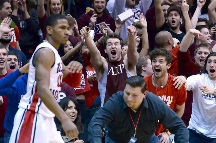 20140220mfrmusports07-1 Robert Morris fans celebrate near the end of the game on a Karvel Anderson three-point shot against LIU.