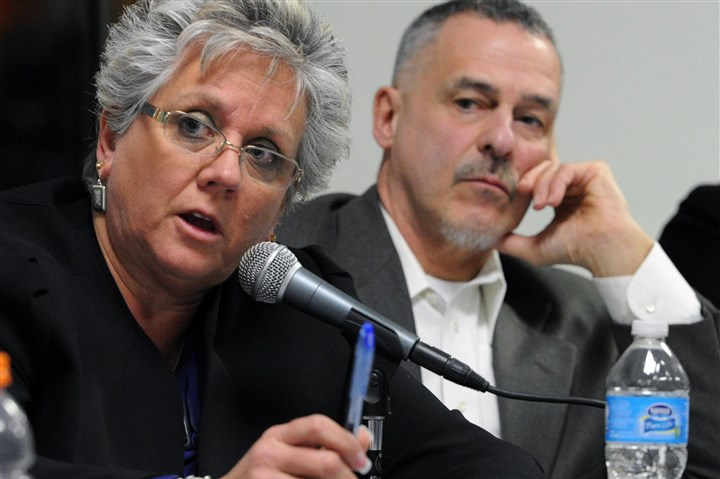 Drilling 2 Findlay supervisors Janet Craig, left, and Thomas Gallant, right, ask questions about the drilling plan around Pittsburgh International Airport.