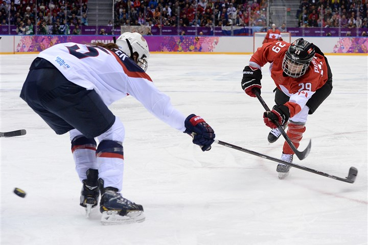 527308964 Canada's Marie-Philip Poulin (R) scores the winning goal during the Women's Ice Hockey Gold Medal Game between Canada and USA at the Bolshoy Ice Dome during the Sochi Winter Olympics on February 20, 2014.
