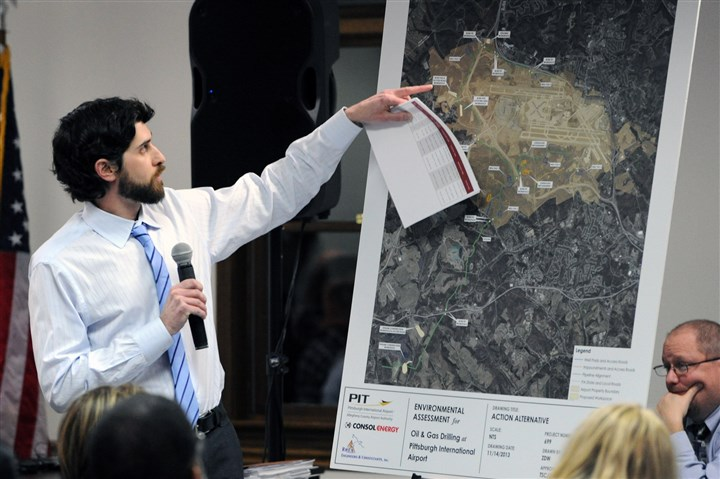 20140220JHLocalDrill07-1 Dan Bitt of Consol Energy shows Findlay residents a map of proposed drilling sites at a public meeting.