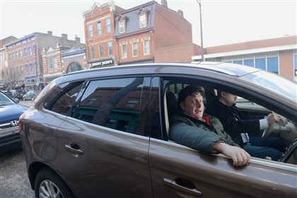 20140221_CabbyGo Joshua Freedman, founder of CabbyGo, rides with Alex Vazquez, right, a driver from Three Rivers Transportation, on Friday in the South Side. Mr. Freedman created the CabbyGo App that connects riders with commercial taxi service.