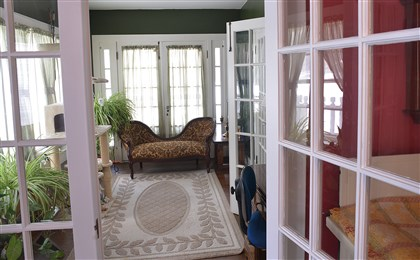 Sunroom off the living room With three sets of French doors, the den looks like a sunroom.