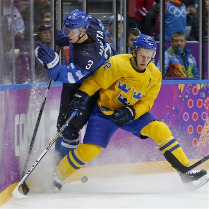 Olli Maatta  Sweden forward Gabriel Landeskog, right, crashes the boards against Finland defenseman Olli Maatta during the third period of a men's semifinal ice hockey game at the 2014 Winter Olympics, Friday, Feb. 21, 2014, in Sochi, Russia.