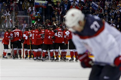 Sochi Olympics Ice Hockey Men Team Canada celebrates after beating the USA 1-0 in a men's semifinal ice hockey game at the Winter Olympics today.