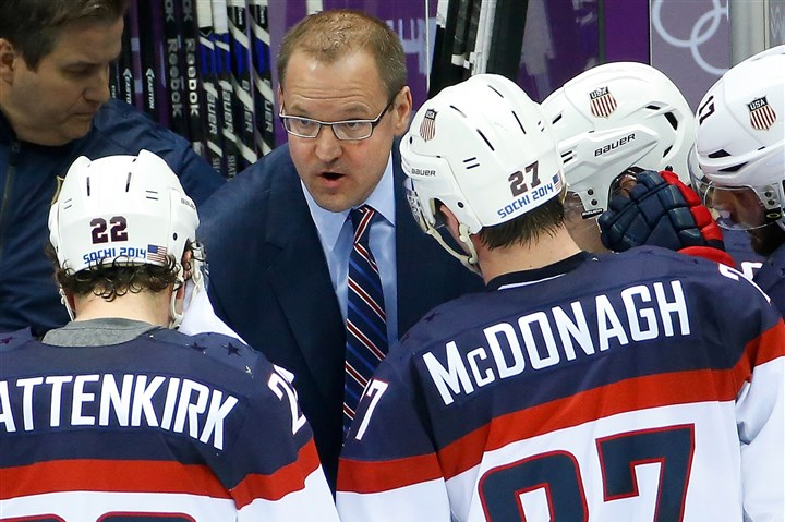 Sochi Olympics Ice Hockey Men USA head coach Dan Bylsma task to the team during a break in the action in the second period of the men's semifinal ice hockey game against Canada at the 2014 Winter Olympics, Friday, Feb. 21, 2014, in Sochi, Russia.