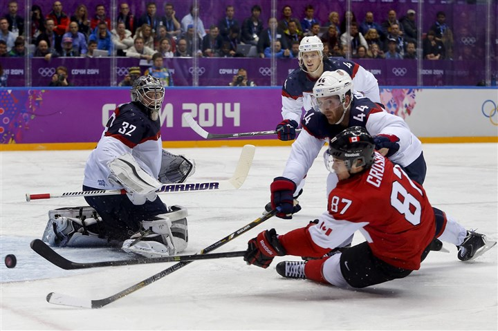 Sid shoots past Brooks ... Canada forward Sidney Crosby shoots the puck against USA defenseman Brooks Orpik as USA goaltender Jonathan Quick defends the goal during the third period of a men's semifinal ice hockey game at the 2014 Winter Olympics, Friday, Feb. 21, 2014, in Sochi, Russia.
