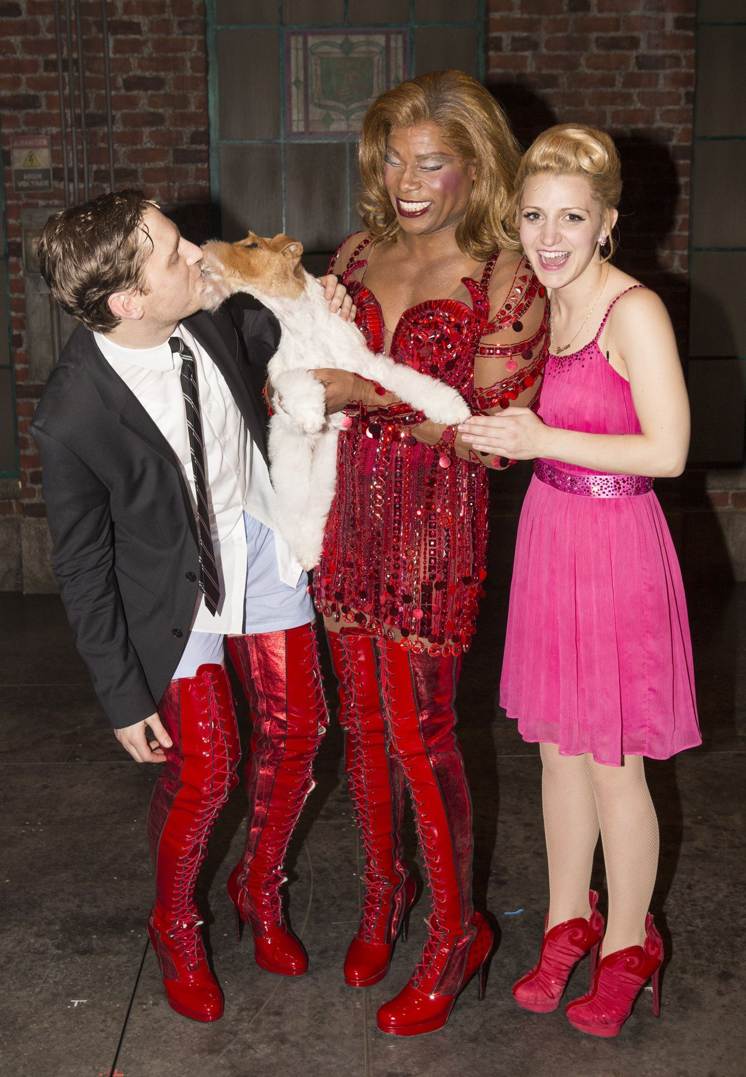 "Westminster winner Sky visits Broadway Billy Porter (in red dress) of Pittsburgh with Andy Kelso, Sky the dog, and Annaleigh Ashford. The wire fox terrier, named best in show at Westminster Kennel Club show, visited backstage at Broadway's ""Kinky Boots."""