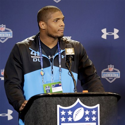 michaelsam0223 Former Missouri defensive end Michael Sam speaks at a news conference at the NFL combine Saturday in Indianapolis.