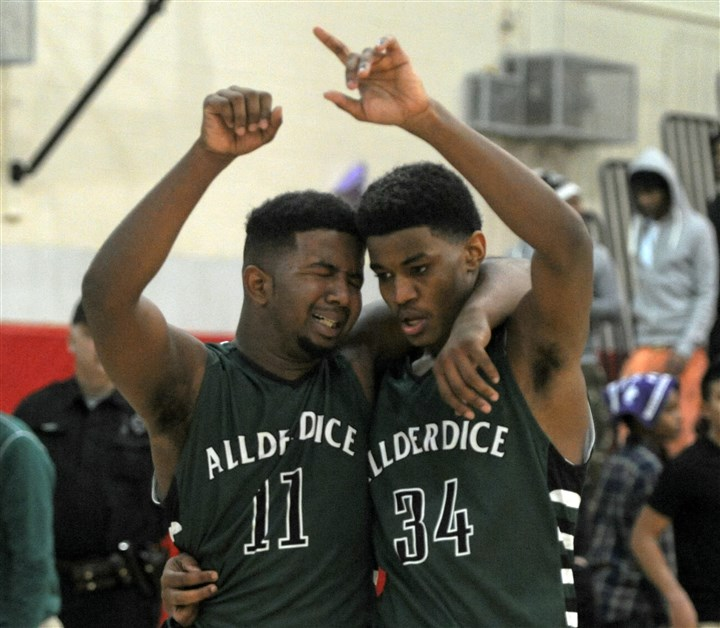 20140222ppChampionship3SPTS Allderdice's Javaughn Moultrie (11) and Alex Bell (34) celebrate after beating Obama Academy in the City League boys basketball championship at Obama Academy.