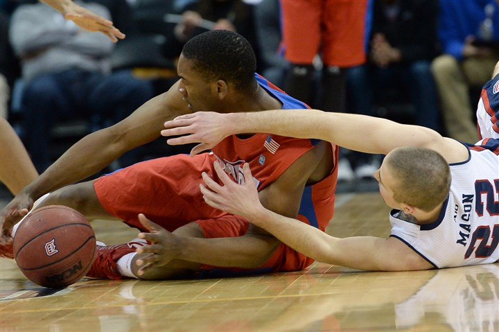 Duquesne's Micah Mason vs Dayton Dayton's Dyshawn Pierre grabs a loose ball against Duquesne's Micah Mason in the first half at Consol Energy Center Saturday afternoon.