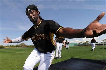Andrew McCutchen at Pirate City Andrew McCutchen mugs for the camera after completing his sliding drill during afternoon workouts at Pirate City in Bradenton, Fla.