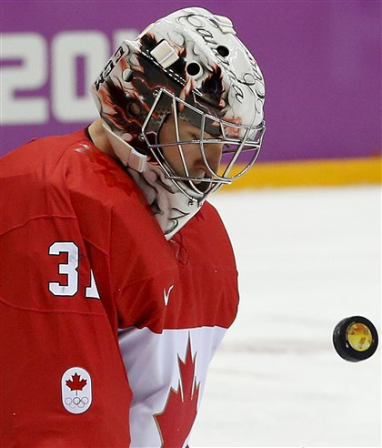 Canada goaltender Carey Price blocks a shot Canada goaltender Carey Price blocks a shot by Sweden during the first period.