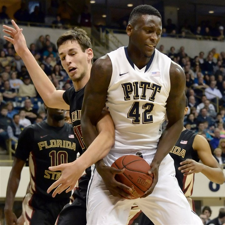 Pitt's Talib Zanna vs. Florida State Pitt's Talib Zanna tries to pull down a rebound against Florida State's Boris Bojanovsky at the Petersen Events Center.