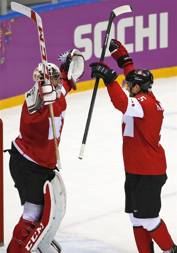 Goalkeeper Carey Price of Canada and Dan Hamhuis Goalkeeper Carey Price of Canada and Dan Hamhuis of Canada celebrate their 3-0 win over Sweden.