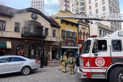 20140224MWHfireLocal08-7 Firefighters respond to a fire in Market Square.
