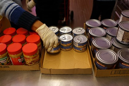 Volunteers stack cans According to a federal survey, women volunteer more than men, and the highest percentage of volunteers, 10.9 percent, deal with food: packing, cooking, distributing and serving.