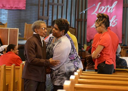 Katie Johnson at Bethel AME Church in the Hill District Katie Johnson, left, is greeted by other parishioners at Bethel AME Church in the Hill District.