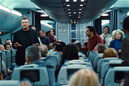 "20140228NonStop4 As U.S. Air Marshal Bill Marks, Liam Neeson tries to calm down passengers in the suspense thriller ""Non-Stop."""