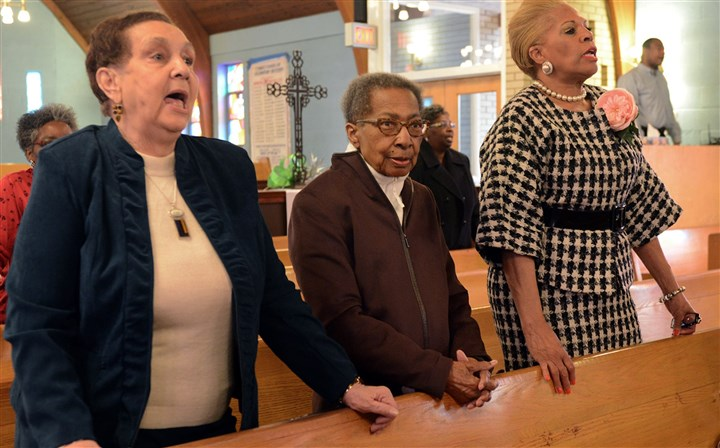2014223RARlocaljohnson4-3 Robin Rombach/Post-Gazette - 2-23-14 - Hill District - local - Katie Johnson, center, 91, attends church at Bethel AME in the Hill District with her friends (left) Velma Croom-Green and Janice Brown. Ms. Johnson's sister, Thelma Witherspoon, died in a fire in January that also destroyed Ms. Johnson's home of 70 years.