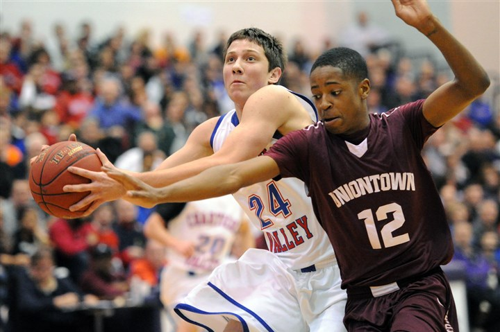 antonucci0226 Chartiers Valley's Joe Antonucci, left, is fouled by Uniontown's Deaundre Winfrey in the first half Tuesday night at Baldwin.