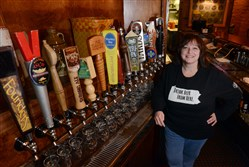 Chris Dilla, founder of Bocktown Beer and Grill in North Fayette, stands next to the beer taps at that location in 2014. In an email blast sent out on Tuesday, Bocktown's owners said it has closed the location at Beaver Valley Mall in Center.