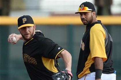Pirates third baseman Brent Morel Pirates third baseman Brent Morel fields ground balls in front of Pedro Alvarez during workouts Thursday at McKechnie Field in Bradenton, Fla.