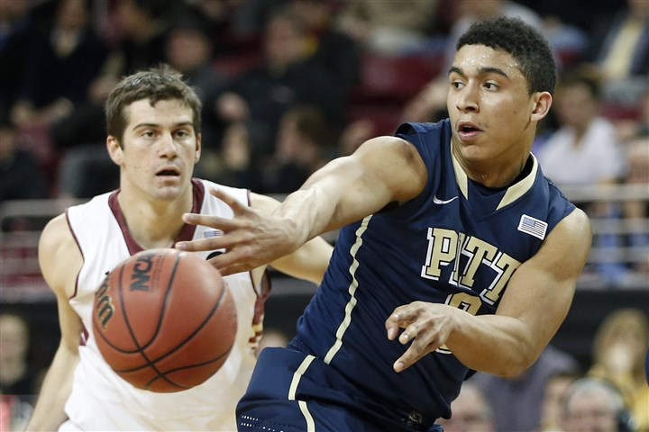 20140226pitt2 Pitt guard James Robinson passes in front of Boston College guard Joe Rahon during the first half of the NCAA college basketball game in Boston.