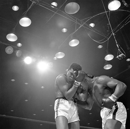 liston0302 Cassius Clay and Sonny Liston do battle in close quarters in their first bout in 1964.
