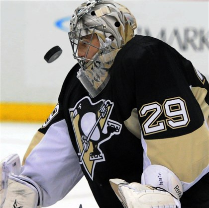 Marc-Andre Fleury gets save vs. Montreal Penguins goalie Marc-Andre Fleury gets a save in the second period against Montreal. Fleury, who faced 29 shots, said he was unhappy with his play in the loss.
