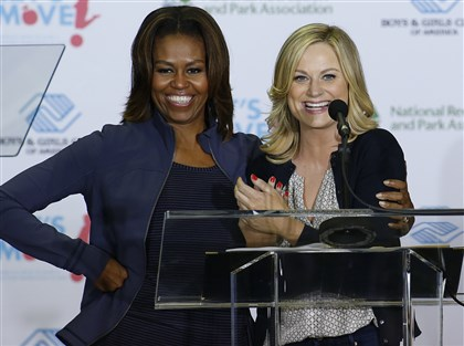 michelleobama-1 Amy Poehler with first lady Michelle Obama at a Miami parks and recreation center.