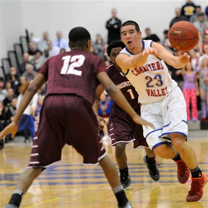 Chartiers Valley Matty McConnell basketball Uniontown's Deaundre Winfrey, left, guards as Chartiers Valley's Matty McConnell, right, passes in a playoff game earlier this week.