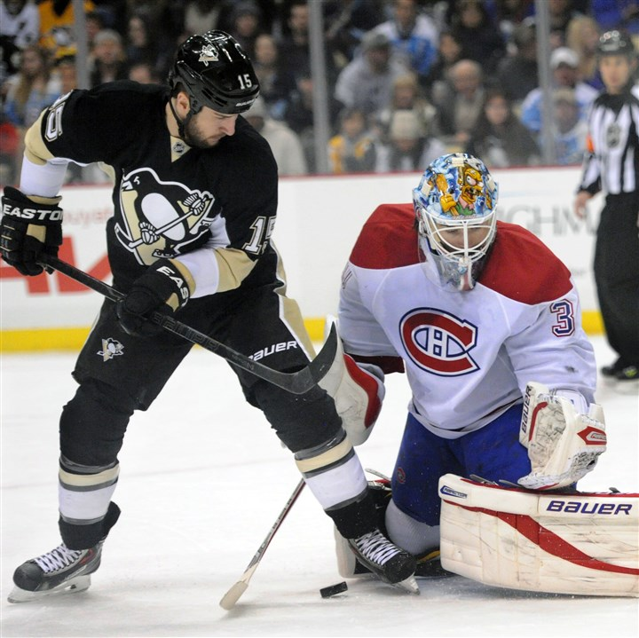 Penguins' Tanner Glass vs. Montreal Penguins left winger Tanner Glass works in front of Montreal goalie Peter Budaj in the first period.