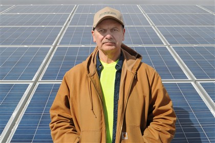 20140227CMNetMeteringBusine.1-1 Jeff Balles, owner of JB Solar LLC, with the solar panels he uses to produce electricity to sell as well as power his own home. Regulations proposed by the Public Utility Commission could harm Balles' solar business.