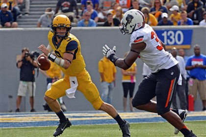 trickett0815 Quarterback Clint Trickett could be at the helm of a more powerful offense this year for West Virginia.