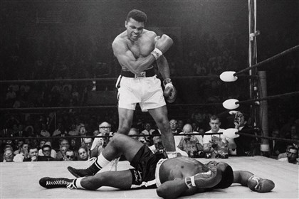 ali0302 The iconic shot of Cassius Clay, as Muhammad Ali was still known, standing over a fallen Sonny Liston in their 1965 rematch.