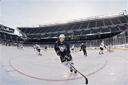 Simon Despres at Soldier Field, Chicago Penguins defenseman Simon Despres practices Friday for his team's outdoor game against the Blackhawks at Soldier Field in Chicago.