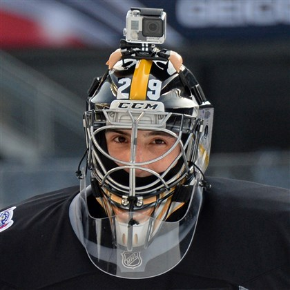 Penguins goaltender Marc-Andre Fleury Penguins goaltender Marc-Andre Fleury wears a GoPro camera on his Steelers-influenced helmet during practice Friday as he prepares for his team's outdoor game against the Blackhawks in Chicago.