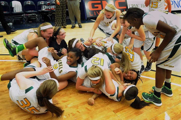 20140228bwGirlsAAspts02-1 The Seton-LaSalle High School girls basketball team celebrates their 65-34 victory over Burrell High School in the WPIAL AA girls basketball championship.