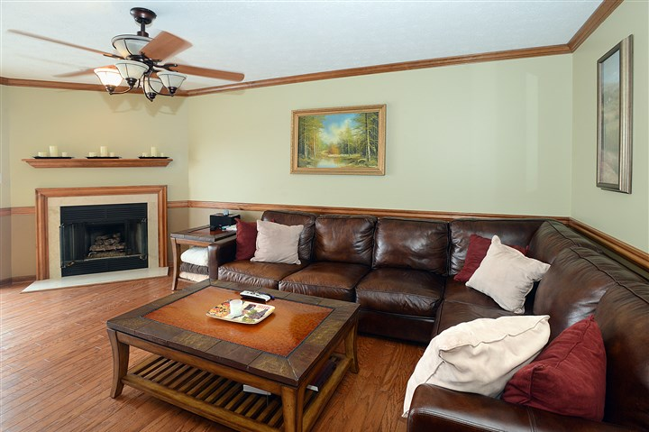 Condo on Shadow Ridge Drive, Harmar 15 Next to the kitchen is the 18- by 13-foot family room with hardwood flooring and a corner gas fireplace and ceiling fan.