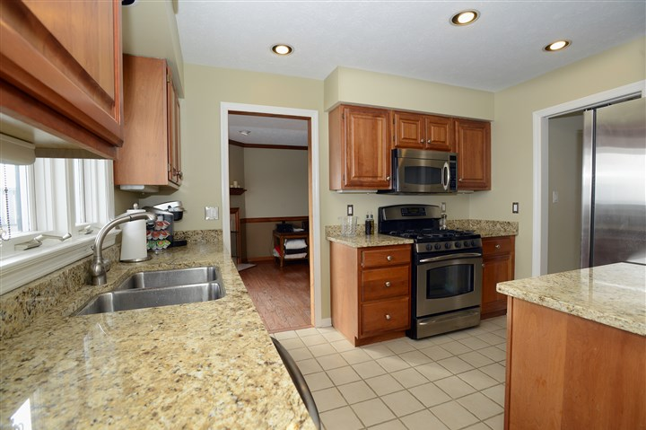 Condo on Shadow Ridge Drive, Harmar 16 The 12- by 9-foot kitchen has solid-wood cabinets and newer stainless-steel appliances including a refrigerator, dishwasher and gas stove with overhead microwave/exhaust fan.
