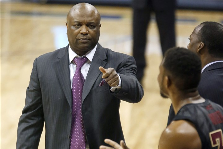 FSU basketball coach Leonard Hamilton vs. Pitt Florida State head coach Leonard Hamilton, left, looks to Ian Miller during the second half of a game against Pitt Feb. 23. Florida State won, 71-66.